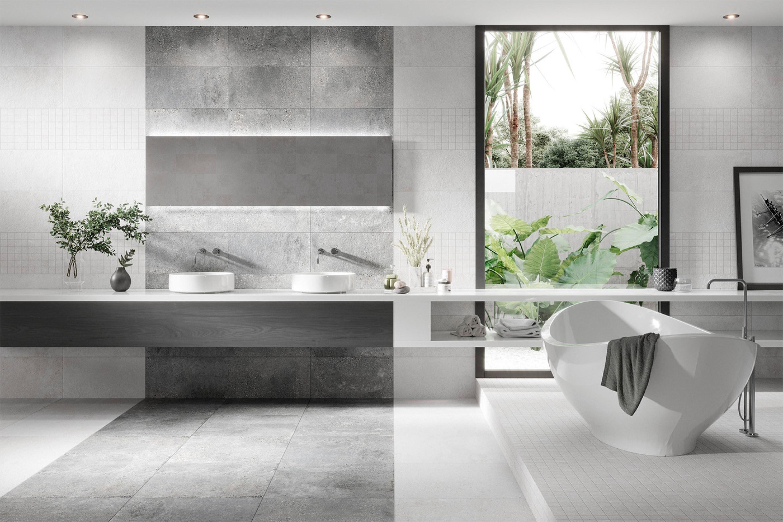Mat grijze betonlook tegels gecombineerd met mat witte tegels en mozaïek