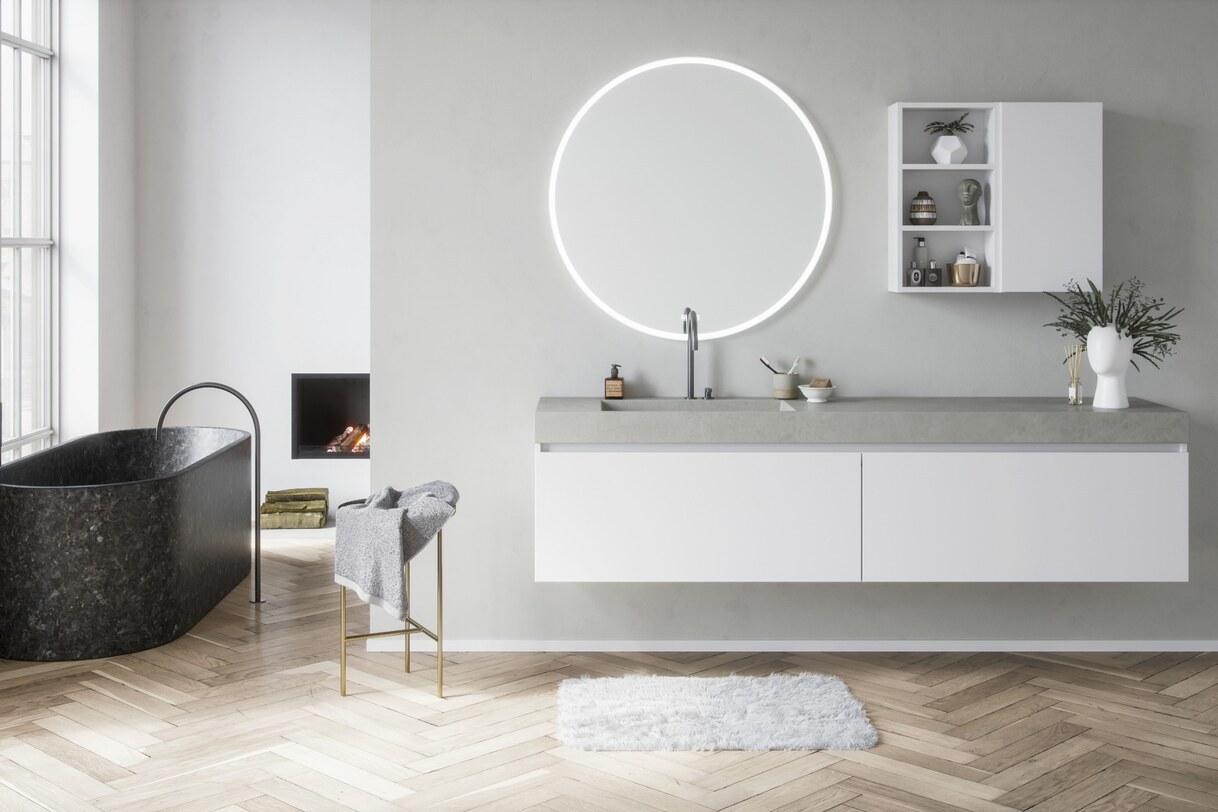 Modern mat wit badmeubel met betonlook wasbak en ronde spiegel