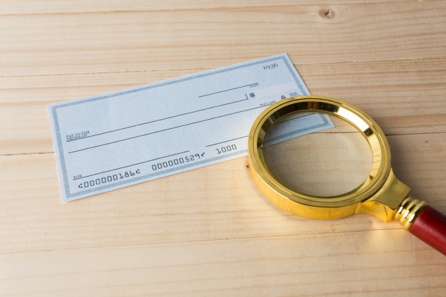 Banking check with magnifier glass 93675 31496
