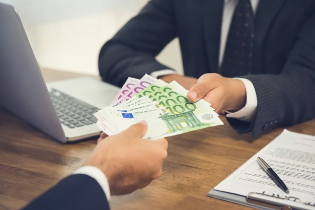 Businessman giving money euro banknotes his partner while making contract 8087 2967