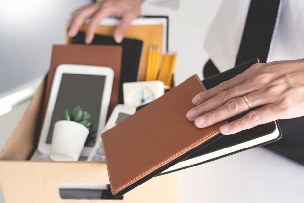 Businessman hold boxes including pot plant documents 1423 3687