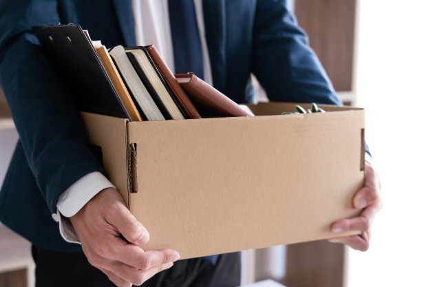 Businessmen are holding resignation document packing personal company brown cardboard box changing work resign concept 1423 3712