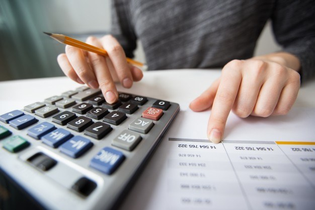 Closeup accountant hands counting calculator 1262 3170