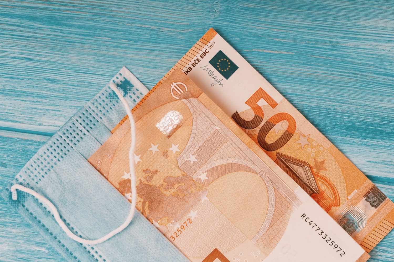 Coronavirus pandemic europe flat lay face mask euro banknotes
