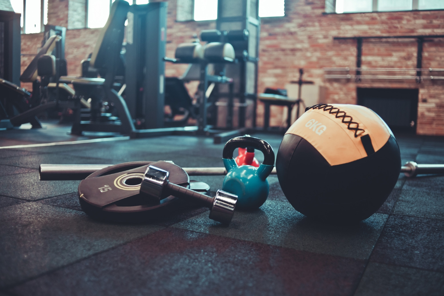 Disassembled barbell medicine ball kettlebell dumbbell lying floor gym sports equipment workout with free weight functional training