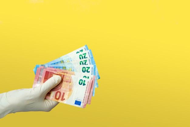 Hand medical gloves holds euro notes quarantine cash donation concept 165109 91