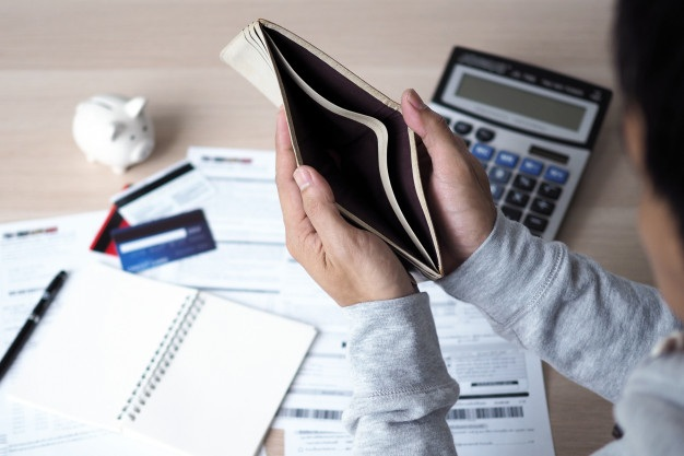 Hands open empty purse after calculating cost from credit card bill debt concept 112699 242