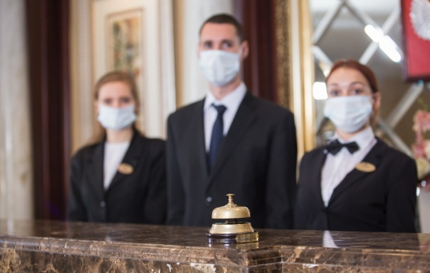 Hotel staff serves guests medical masks 110955 1350