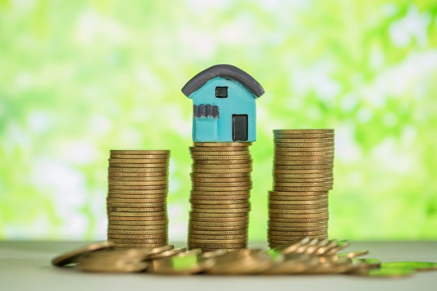 Mini house stack coins with green blur 1150 14845