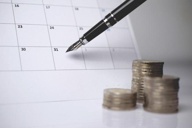 Pile coins pen calendar 27634 117