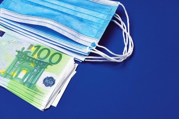 Pile medical face masks euro banknotes blue background 93675 86085