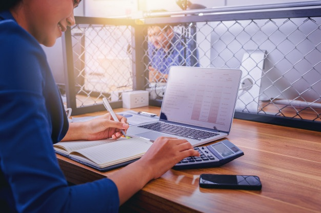 Woman accountant working using calculator calculate financial report workplace 38335 356