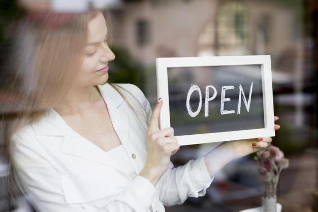 Woman holding open sign coffee shop window 23 2148581175