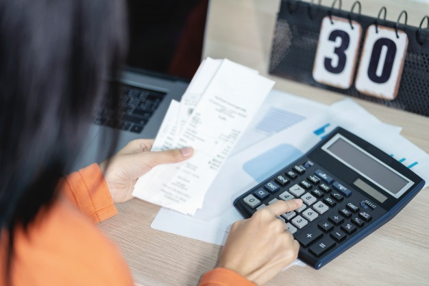 Woman is pressing calculator calculate cost bill dealing finance income 42687 430