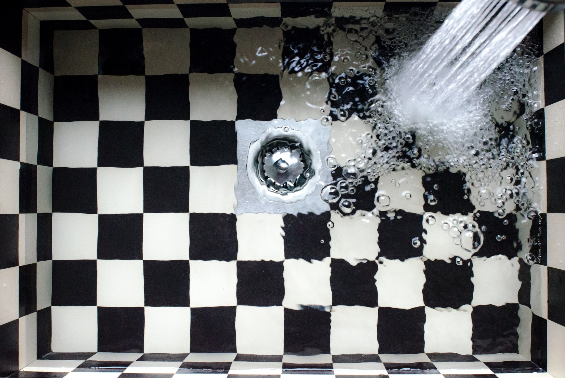Nice checkered sink with hot water system doing well filling it up.
