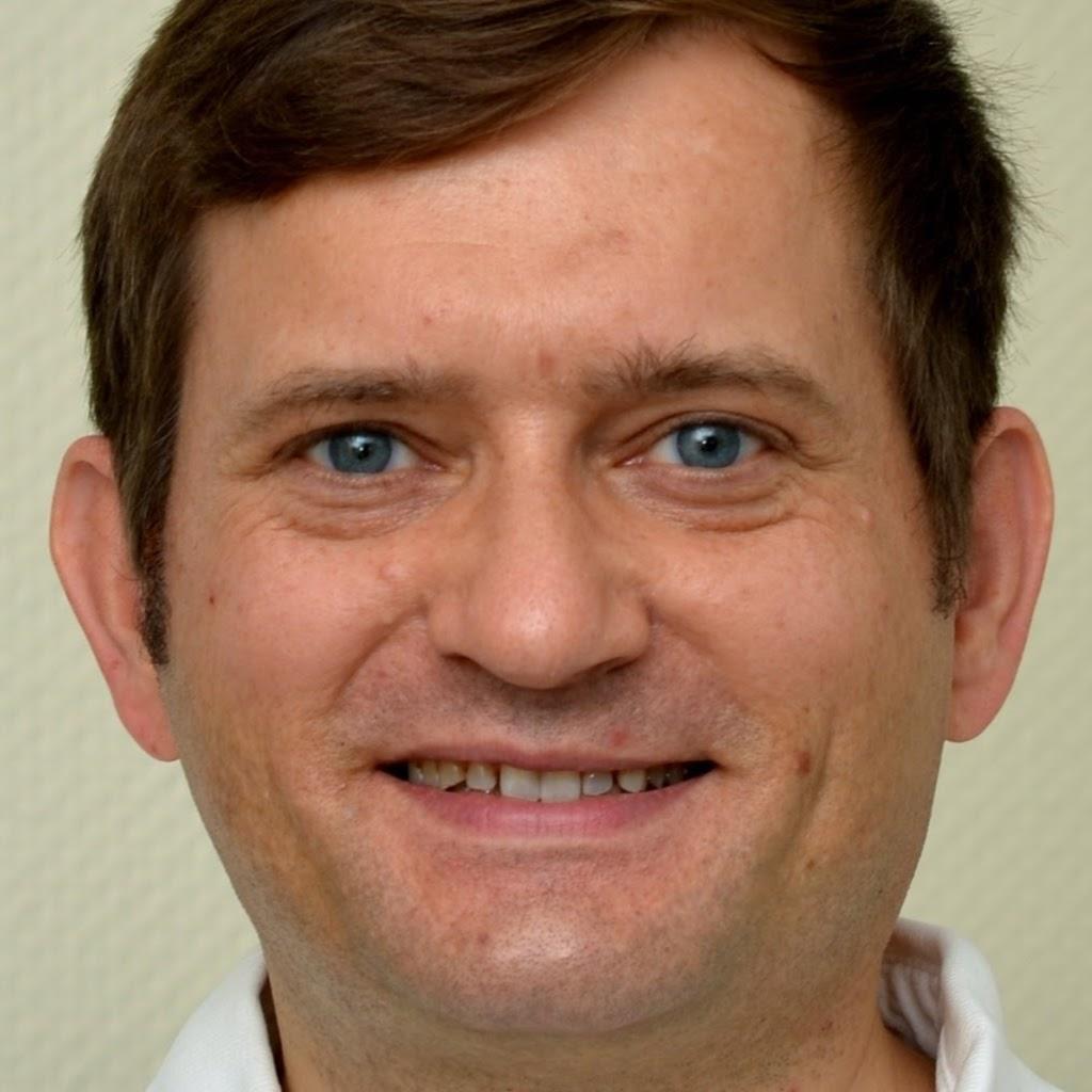 Zahnarzt T. J. Ruder
