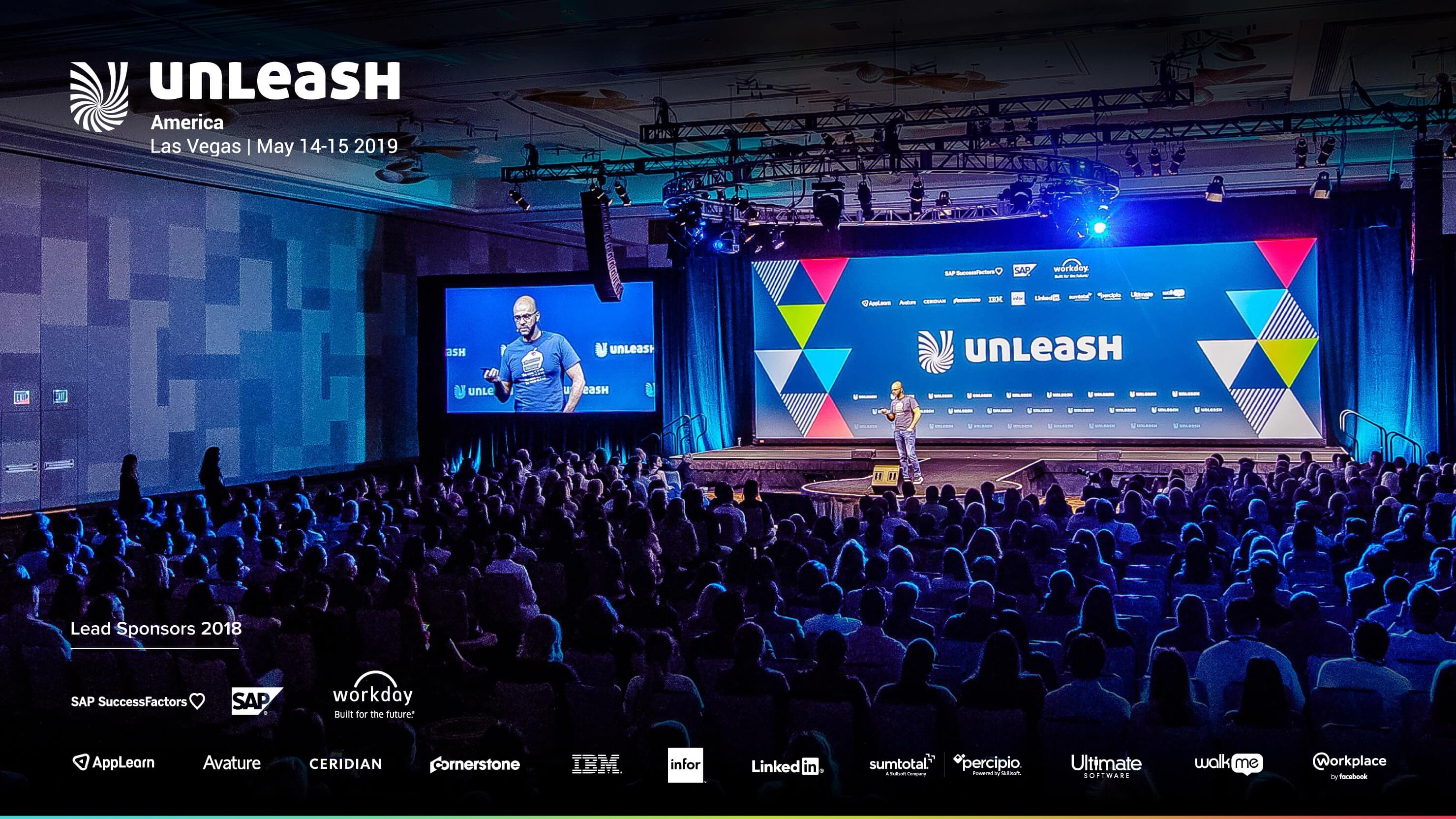 crowd sitting in front of the main stage at unleash