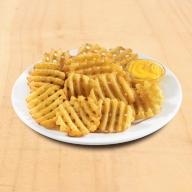 Πατάτες Crosscut με Cheddar sauce