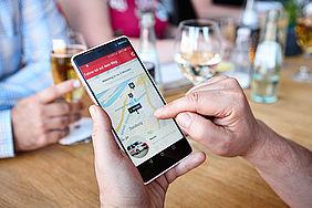 Smartphone mit MyBUS-App