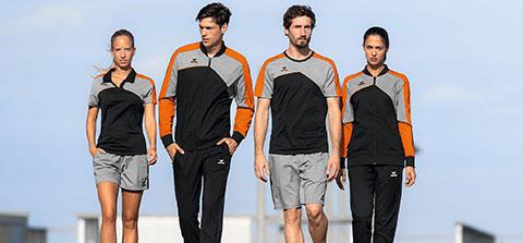 4 Sportler laufen in Sportkleidung