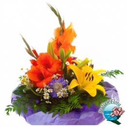 Composizione esotica di fiori gialli e arancio - Consegna in Italia.