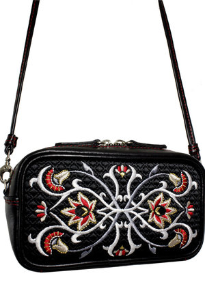 Leather bag decorated with embroidery