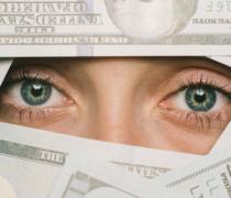 Frauen Augen schauen durch Dollarscheine